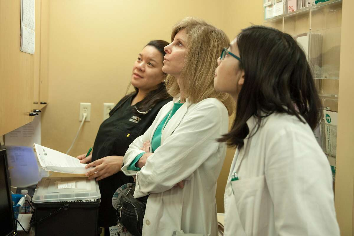 April Dela Cruz, Dr. Laurie Green, founder of the Maven Project, a group that tries to improve access to health care via telemedicine and physician assistant Julie Huynh checks the patients list betweens visits on Saturday 20 January 2018 in San Francisco, CA.