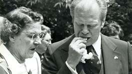 President Gerald Ford eating a tamal, shuck and all, April 9, 1976.
