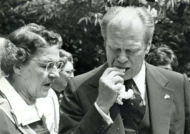 In a Express-News file photo of President Gerald Ford attempts to eat a tamal, shuck and all, April 9,1976.