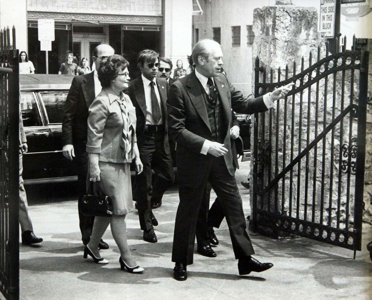 President Gerald Ford and San Antonio Mayor Lila Cockrell enter the grounds of the Alamo during his visit in 1976.