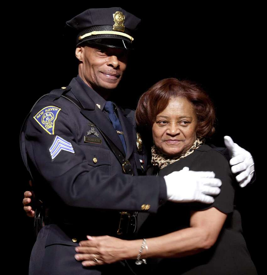 New Haven police Sgt. Joseph Roberts is photographed with his mother, Rachel Washington, who pinned on his new badge Friday.