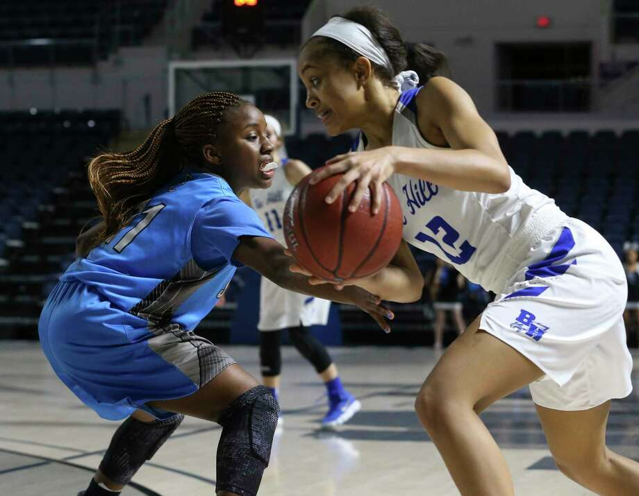 Shadow Creek's Da'Nae Williams (11) tries to steal the ball from Barbers Hill's Kenedi Lewis (12) during the second half of a playoff game at Delmar Fieldhouse on Friday, Feb. 16, 2018, in Houston. The Barbers Hill Lady Eagles defeated Shadow Creek Sharks 89-49. Photo: YCL, Houston Chronicle / © 2018 Houston Chronicle