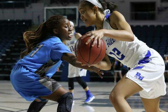 Shadow Creek's Da'Nae Williams (11) tries to steal the ball from Barbers Hill's Kenedi Lewis (12) during the second half of a playoff game at Delmar Fieldhouse on Friday, Feb. 16, 2018, in Houston. The Barbers Hill Lady Eagles defeated Shadow Creek Sharks 89-49.