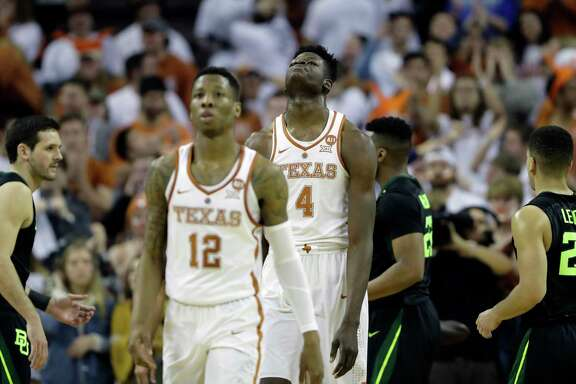 Texas' Kerwin Roach II (12) and Mo Bamba (4) were in search of answers as they walked off the court after losing to Baylor on Monday - the Longhorns' third consecutive loss.      Texas' Kerwin Roach II (12) and Mo Bamba (4) were in search of answers as they walked off the court after losing to Baylor on Monday - the Longhorns' third consecutive loss.