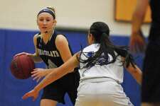 Immaculate's Caroline Wax looks to move the ball during a game against Newtown on Friday.
