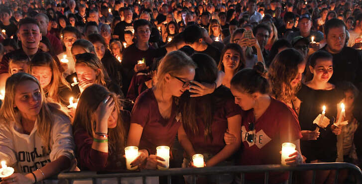 A candlelight vigil Thursday drew hundreds for the victims of the shooting at Marjory Stoneman Douglas High School in Parkland, Fla. (Jim Rassol/Sun Sentinel/TNS)