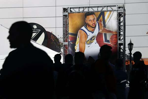 The likeness of Golden State Warriors' Stephen Curry is displayed outside Staples Center during NBA All Star Weekend in Los Angeles, Calif., on Friday, February 16, 2018.