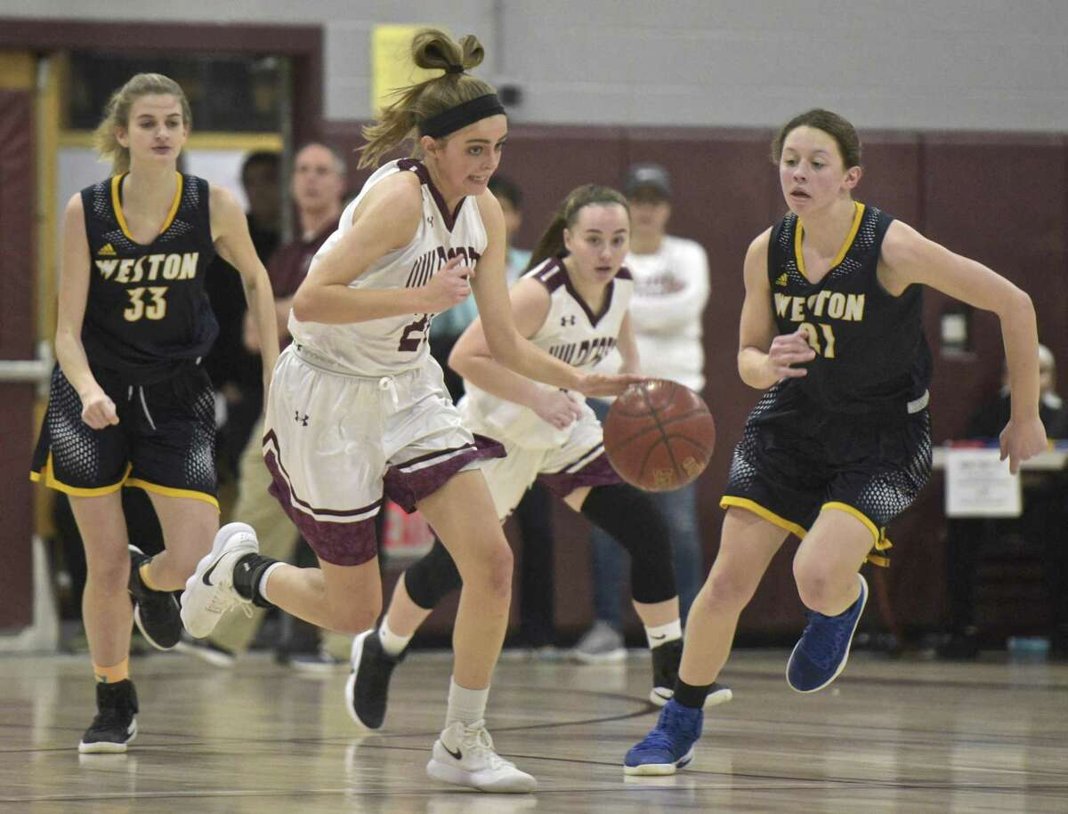Bethel's Britney Roach (24) races down the court followed by Weston's Kate Joyce (21) on Friday.