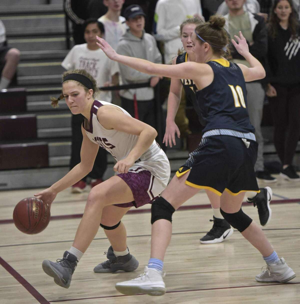 Bethel's Lily Daniels (14) drives around Weston's Georgia Burkard (10) in the girls SWC basketball quarterfinal game between Weston and Bethel high schools. Friday night, February 16, 2018, at Bethel High School, in Bethel, Conn.