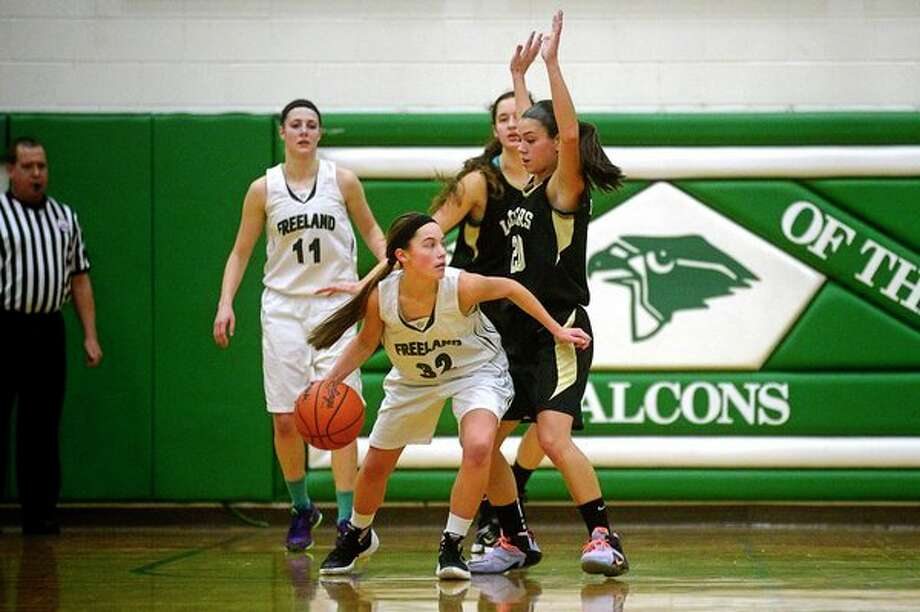 ERIN KIRKLAND | ekirkland@mdn.net 				Freeland's Kaylee Argyle tries to get past Bullock Creek's Makayla Sasse during a game last year in this Daily News file photo.