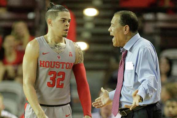 Rob Gray, left, and coach Kelvin Sampson know UH still has work to do to improve its NCAA Tournament position.