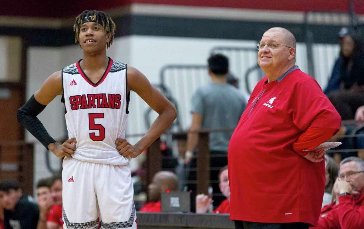 Porter head coach Tobin Reid shares a laugh with guard Jevon Burton (5) during the third quarter of a District 21-5A high school boys basketball game at Porter High School, Tuesday, Dec. 12, 2017, in Porter.