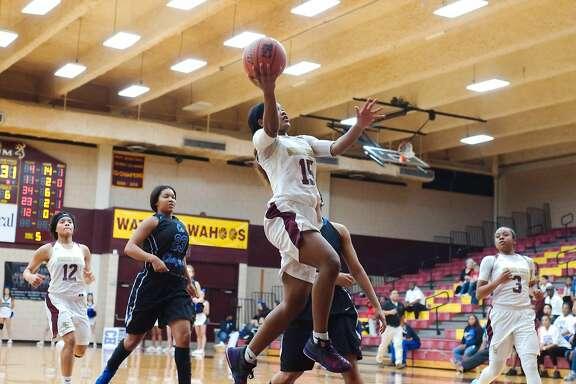 Summer Creek's Halle Jones (15) drives to the basket against Clear Springs Friday, Feb. 16 at Deer Park High School.