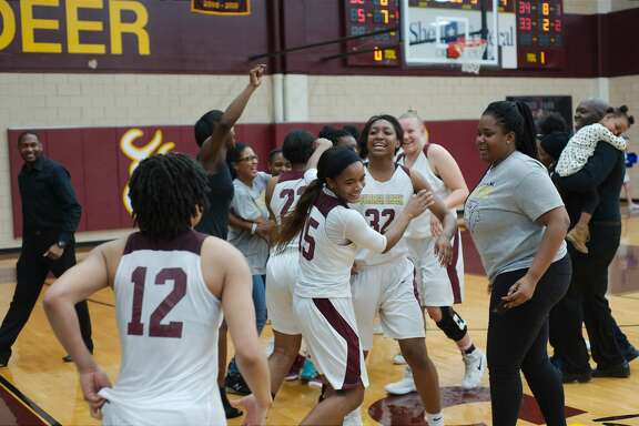 Summer Creek celebrates a victory over Clear Springs Friday, Feb. 16 at Deer Park High School.