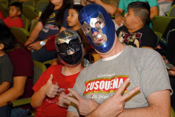 Nathan and Jason Pettrey during the Aro Lucha wrestling event at the Beaumont Civic Center on Friday night.  Photo taken Friday 2/16/18 Ryan Pelham/The Enterprise