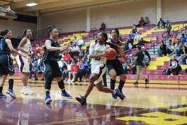 Summer Creek's Halle Jones (15) drives to the basket against Clear Springs Friday at Deer Park High School.