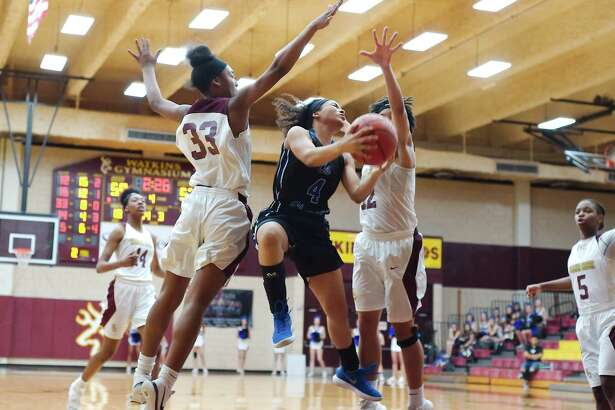Clear Springs' Dymond Gladney (4) was recently named most valuable player on the all-District 24-6A girls' basketball team.