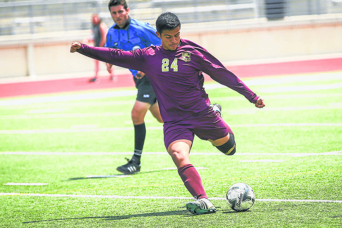 Magnolia West's Kevin Aguilar (24) kicks the ball during the high school boys soccer game against Goose Creek Memorial on Friday, April 8, 2016, at Turner Stadium. To view more photos from the game, go to HCNPics.com.