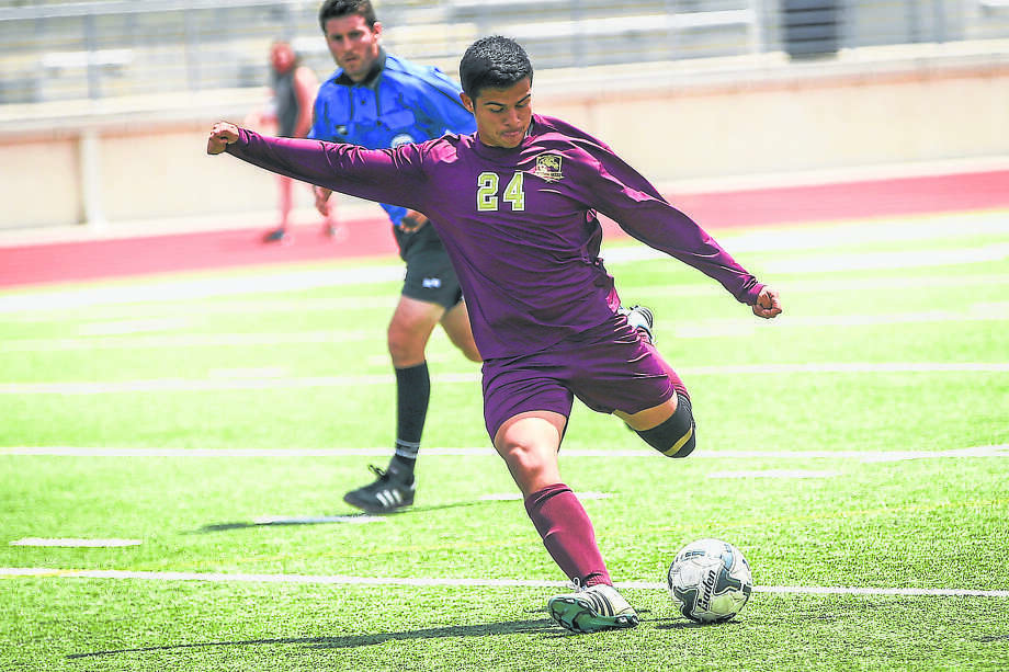Magnolia West's Kevin Aguilar (24) kicks the ball during the high school boys soccer game against Goose Creek Memorial on Friday, April 8, 2016, at Turner Stadium. To view more photos from the game, go to HCNPics.com. Photo: Michael Minasi, Photographer / Internal