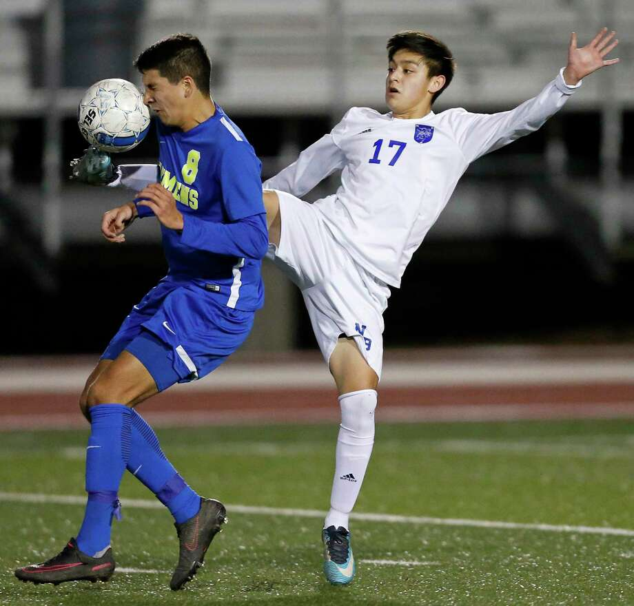 Clemens' Nicolas Mora (left) and New Braunfels' Dylan Navarijo go after the ball during first half action Friday Feb. 16, 2018 at Unicorn Stadium in New Braunfels, Texas. Photo: Edward A. Ornelas, Staff / San Antonio Express-News / © 2018 San Antonio Express-News