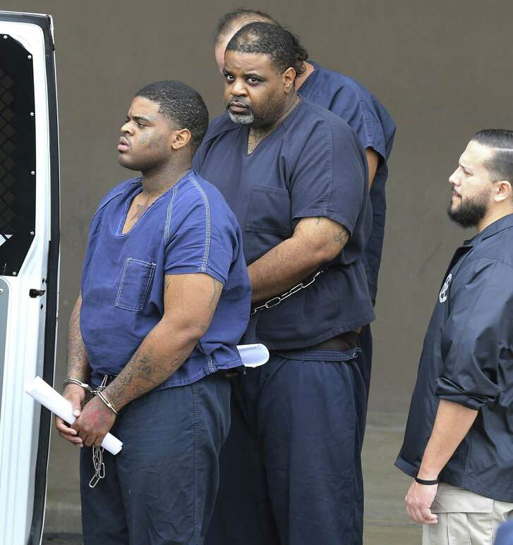 Two of the three suspects are seen after they were brought to the federal courthouse in San Antonio to face federal bank robbery charges after their arrests by San Antonio police.