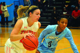 Edwardsville senior forward Rachel Pranger drives past Belleville East guard Kaylah Rainey in the first quarter.
