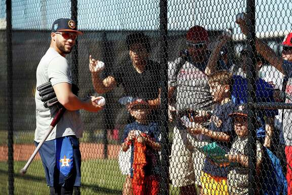 You can't spell Springer without spring. And you can't have an Astros spring training without outfielder George Springer, left, who spends part of his first day in camp autographing baseballs for fans at The Ballpark of the Palm Beaches on Friday.