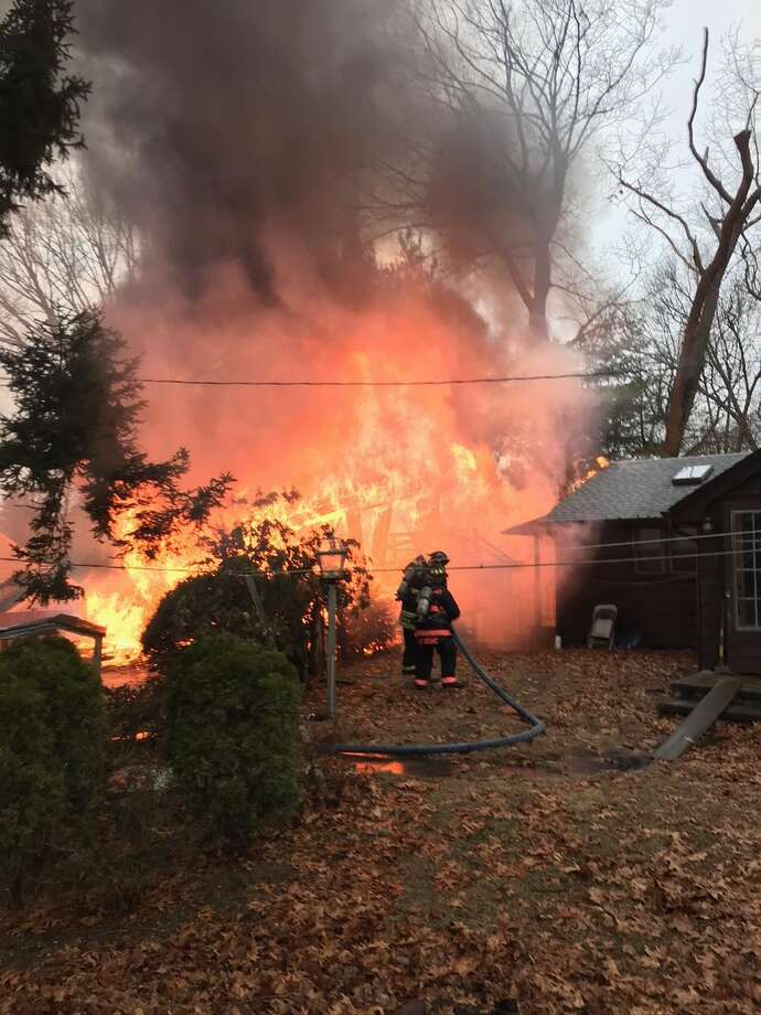 The Westport Fire Department responded to a building fire in Westport on Remlin Court Friday, February 16. Photo: Contributed Photo/Westport Fire Department