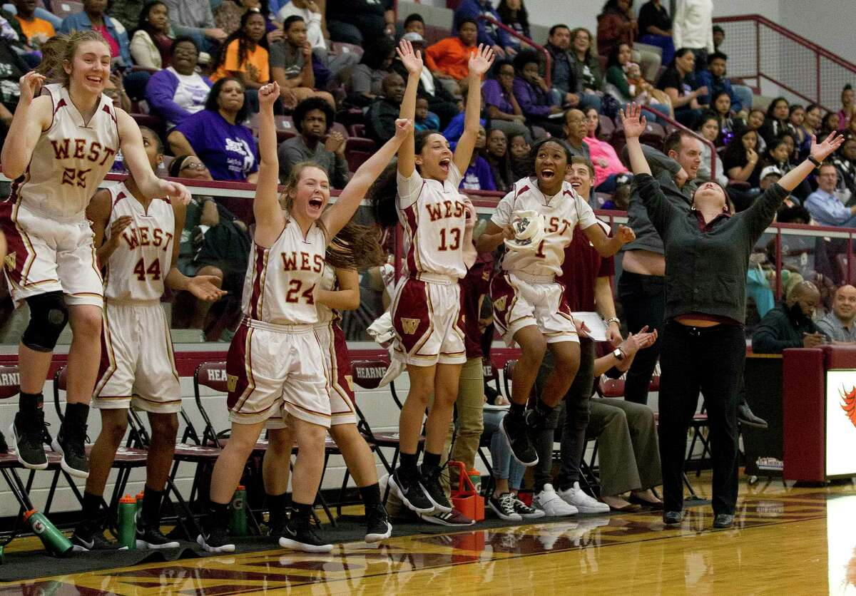 Magnolia West head coach Sarah Simmons reacts beside players after defeating Waco University 69-59 during a Region III-6A area high school playoff game at Hearne High School, Friday, Feb. 16, 2018, in Hearne.