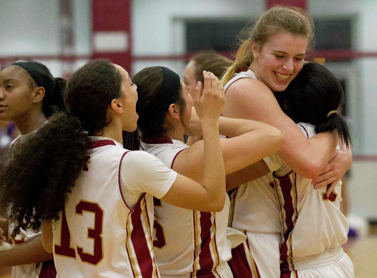 Magnolia West players react after defeating Waco University 69-59 during a Region III-6A area high school playoff game at Hearne High School, Friday, Feb. 16, 2018, in Hearne.