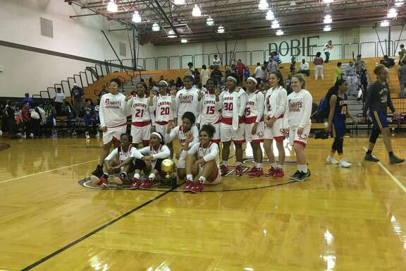 The Crosby Lady Cougars pose after beating the Elkins Lady Knights on Feb. 16 at Dobie High School in Pasadena to win the Area championship. Some players hold up three fingers signifying the team's advancement to the third round of the playoffs, the regional quarterfinals.