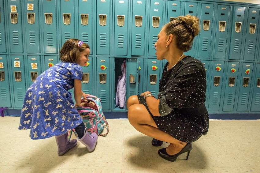 Kindergarten student Amelia Millard, left, speaks with Rachel Mitchell, school psychologist as she gets her locker organized on the first day of school at the Lake Avenue Elementary School on Wednesday, Sept. 6, 2017, in Saratoga Springs, N.Y. (Skip Dickstein/Times Union archive)