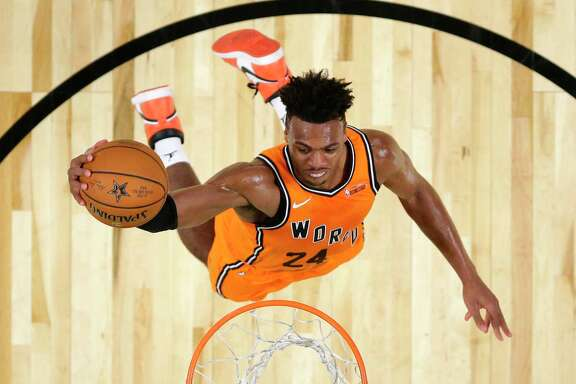 World Team's Buddy Hield, of the Sacramento Kings, goes up for a dunk during the NBA All-Star Rising Stars basketball game U.S. Team, Friday, Feb. 16, 2018, in Los Angeles. (AP Photo/Mark J. Terrill, Pool)