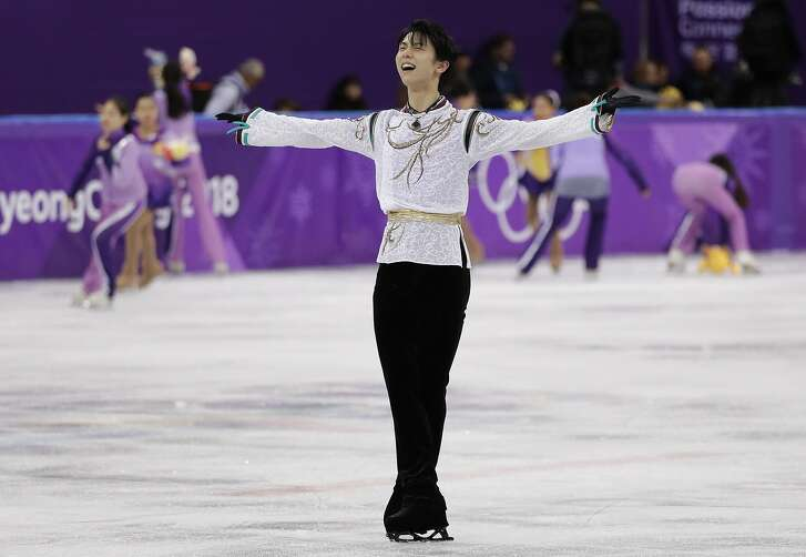 Yuzuru Hanyu of Japan reacts after his performance in the men's free figure skating final in the Gangneung Ice Arena at the 2018 Winter Olympics in Gangneung, South Korea, Saturday, Feb. 17, 2018. (AP Photo/David J. Phillip)