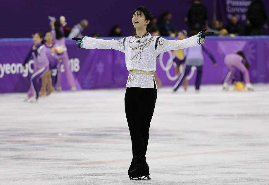 Yuzuru Hanyu of Japan reacts after his performance. He became the first man to repeat as Olympic figure skating champion since Dick Button in 1952. Japan's Shoma Uno won silver. Photo: David J. Phillip, Associated Press
