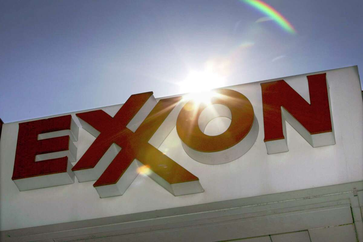 This Oct. 26, 2006 file photo shows an Exxon logo seen at a Dallas gas station. Exxon has once again surpassed Apple as the world's most valuable company after the iPhone and iPad maker saw its stock price falter, according to reports Friday, Jan. 25, 2013. Apple first surpassed Exxon in the summer of 2011. The two companies traded places through that fall, until Apple surpassed Exxon for good in early 2012. (AP Photo/LM Otero, File)