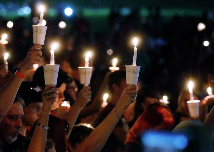 A candlelight vigil Thursday drew hundreds for the victims of the shooting at  Marjory Stoneman Douglas High School in Parkland, Fla.  (AP Photo/Wilfredo Lee)