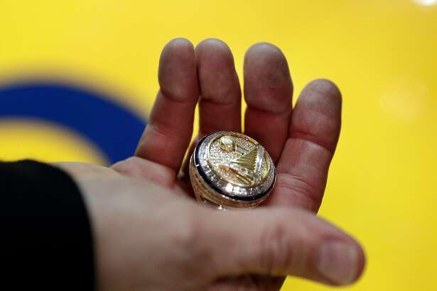 Warriors owner Peter Guber shows his ring to guests before the Golden State Warriors played the Houston Rockets at Oracle Arena in Oakland, Calif., Tuesday, October 17, 2017.