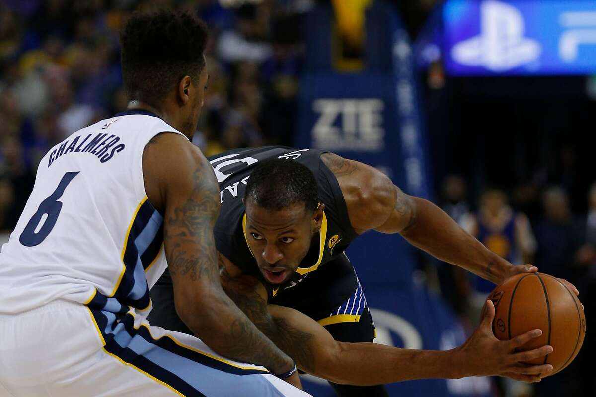 Golden State Warriors forward Andre Iguodala (9) is defended by Memphis Grizzlies guard Mario Chalmers (6) during the first half of an NBA basketball game between the Golden State Warriors and Memphis Grizzlies at Oracle Arena, Saturday, Dec. 30, 2017 in Oakland, Calif. The Warriors won 141-128.