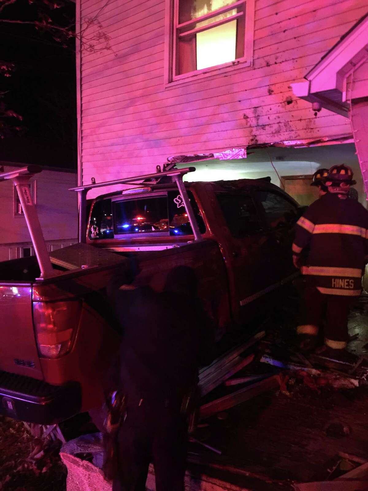 A pickup truck crashed into an occupied Danbury home, sending three people to the hospital and displacing more on Saturday, Feb. 17.