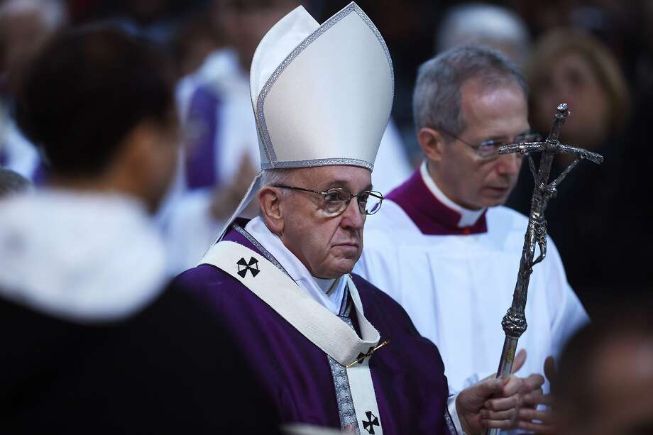 Pope Francis leaves after leading the Ash Wednesday mass which opens Lent, the forty-day period of abstinence and deprivation for Christians before Holy Week and Easter, on February 14, 2018, at the Santa Sabina church in Rome.  / AFP PHOTO / Filippo MONTEFORTEFILIPPO MONTEFORTE/AFP/Getty Images Photo: FILIPPO MONTEFORTE, AFP/Getty Images
