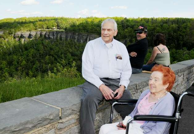 Bill and Patricia Bosch, of Slingerlands, enjoy the view from the retaining wall Sunday at the Overlook at John Boyd Thacher State Park in the town of New Scotland. (Luanne M. Ferris / Times Union) Photo: LUANNE M. FERRIS