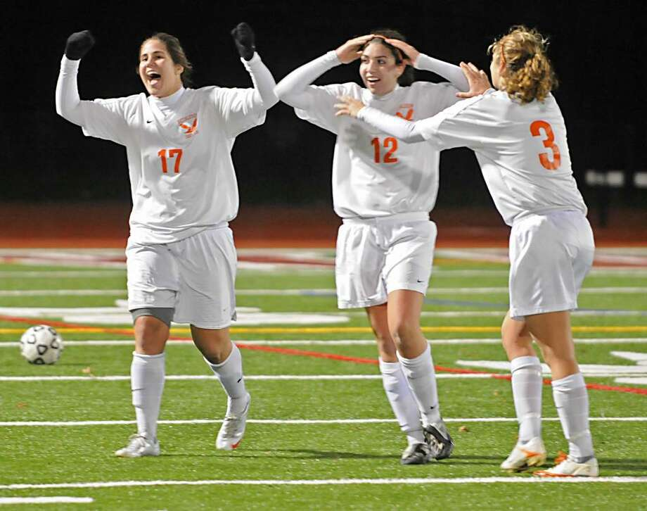From left, Kristina Maksuti, Heather Varcasia and Marjana Maksuti of Bethlehem celebrate after winning the Class AA girls' soccer title game against Shenendehowa on Wednesday, November 11, 2009, in Clifton Park.  (Lori Van Buren / Times Union) Photo: LORI VAN BUREN