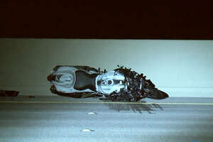 A man speeding down the Gulf Freeway on his motorcycle was killed Saturday morning after running into the back of a car, according to local authorities.
