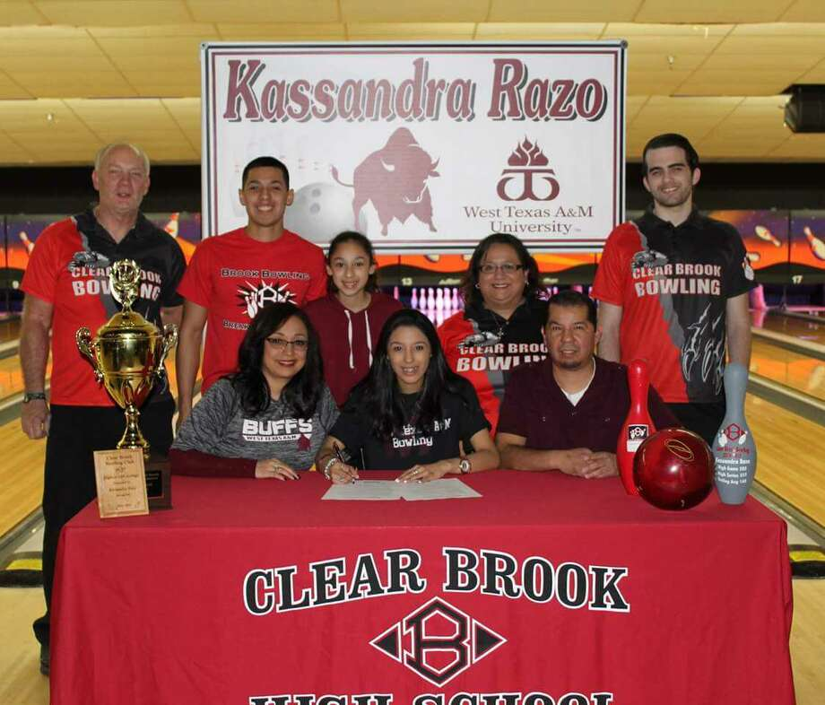 Kassandra Razo has signed national bowling letter of intent with West Texas A& University. Pictured are (back row, left to right) coach Cecil Rutherford, Ernest Razo, Rubi Razo, coach Roxy Casas, coach Dario Vaccaro (front row) mother Yesenia Razo, Kassandra Razo, and father, Rodney Razo. Photo: Submitted Photo