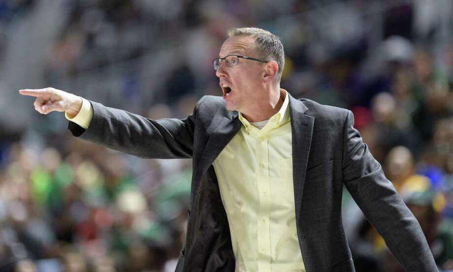 Klein Forest Eagles Head Coach, Cary Black yells in instructions to his team against the Westfield Mustangs in a 6A Bi-District playoff game on Tuesday, February 28, 2017 at the Delmar Fieldhouse in Houston, Texas. Photo: Wilf Thorne / © 2017 Houston Chronicle
