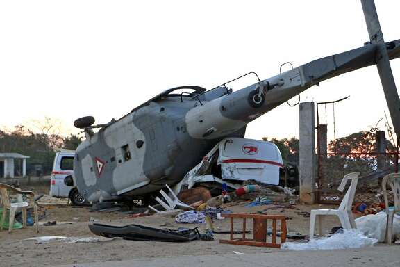 View of the remains of the military helicopter that fell on a van in Santiago Jamiltepec, Oaxaca state, Mexico, on February 17, 2018.  A 7.2-magnitude earthquake rattled Mexico on Friday, causing little damage but triggering a tragedy when a minister's helicopter crash-landed on the way to the epicenter, Oaxaca, killing two people on the ground. / AFP PHOTO / PATRICIA CASTELLANOSPATRICIA CASTELLANOS/AFP/Getty Images