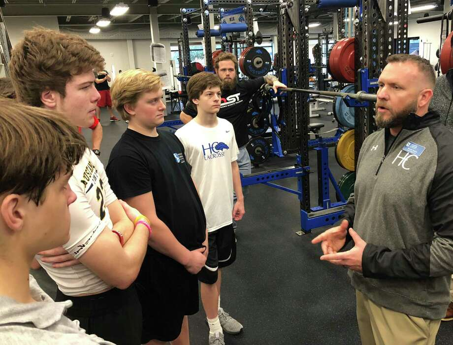 Houston Christian football coach David Nelson addresses players in the school's training facility during an offseason workout. Nelson was hired as head coach this month after a year of mission work in Kenya. Photo: Houston Christian High School
