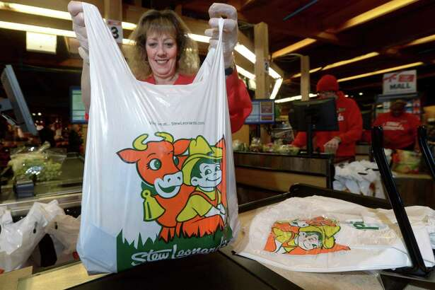 Cashier Carol Peninpede bags groceries with Stew Leonard's iconic plastic bags at the store Wednesday, January 31, 2018, in Norwalk, Conn. Norwalk Council Member Tom Livingston is considering whether plastic bags should be banned in the city following trends in neighboring Wilton and Westport.
