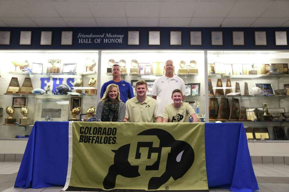 Jake Yurachek of Friendswood signed a letter of intent to play football for Colorado.  He was joined at the signing by his mother Jennifer Yurachek, his brother Brooks Yurachek, coach Jamie Crocker and FHS Athletic Director Robert Koopmann. Photo: Submitted Photo